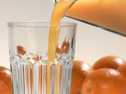 pouring orange juice from a pitcher to a glass - pitcher jug stock videos & royalty-free footage