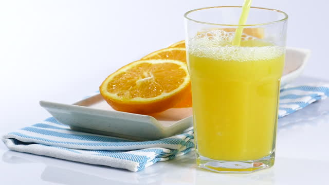 pouring orange juice into a glass - orange juice stock videos & royalty-free footage