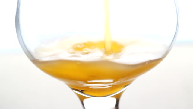 pouring orange juice into glass - orange juice stock videos & royalty-free footage