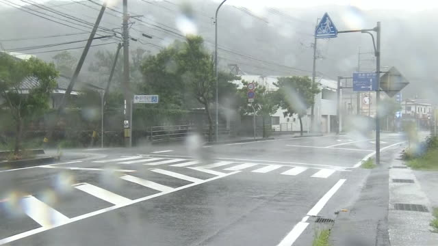 pouring rain beating street, kochi, japan - cyclone stock videos & royalty-free footage