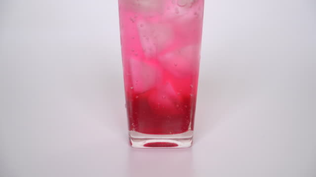pouring red sweet soft drink