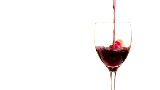 pouring red win - isolated on white - white background stock videos & royalty-free footage