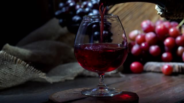 pouring red wine cinemagraph - wine cask stock videos and b-roll footage