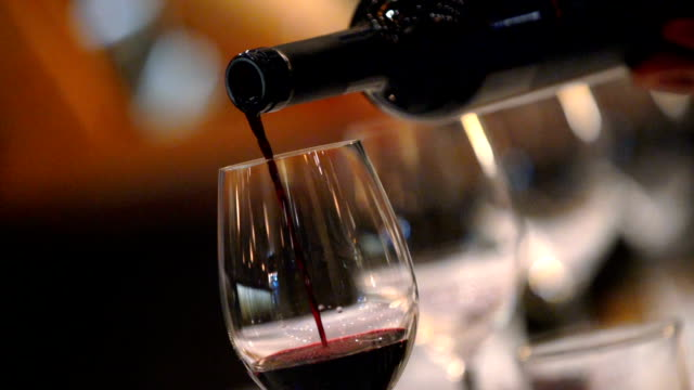 pouring red wine in slow motion. - wine stock videos & royalty-free footage