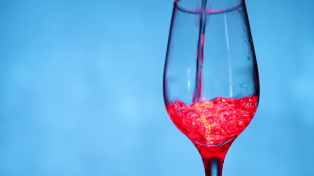 Pouring red wine in the wineglass