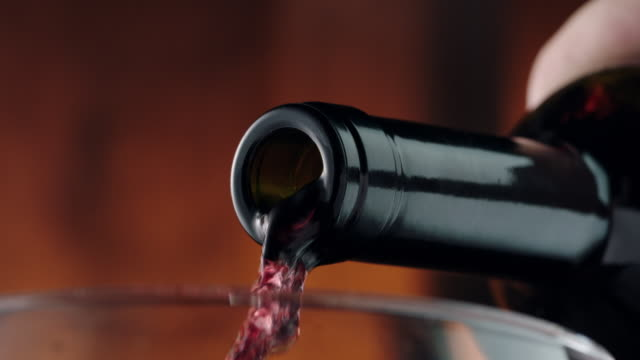 pouring red wine into glass - bicchiere da vino video stock e b–roll