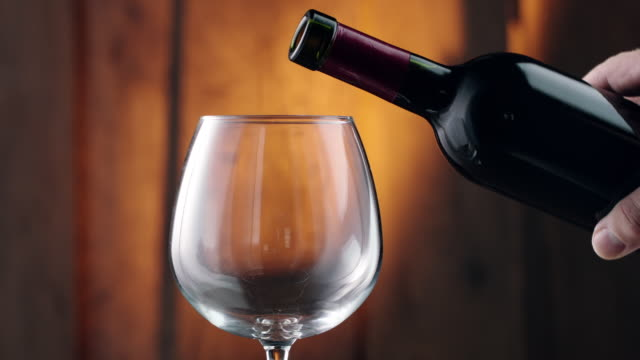 pouring red wine into glass - physical activity stock videos & royalty-free footage
