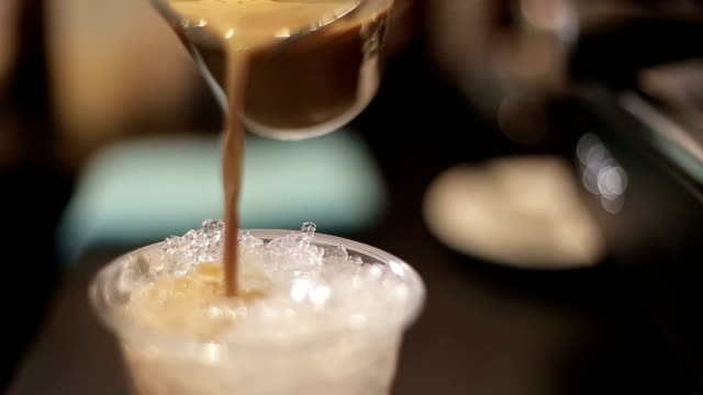 pouring refreshment - cafe macchiato stock videos and b-roll footage