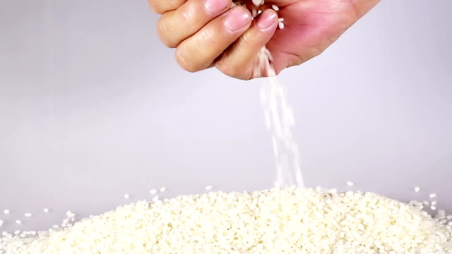 Pouring rice, pan and slow motion