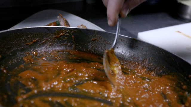 pouring sauce from pan over served stuffed meat rolls - crockery stock videos & royalty-free footage