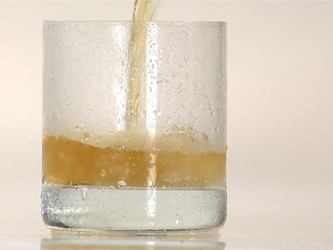 pouring scotch into a glass with crushed ice - crushed ice stock videos & royalty-free footage