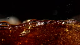 Pouring soft drink into glass, Slow Motion