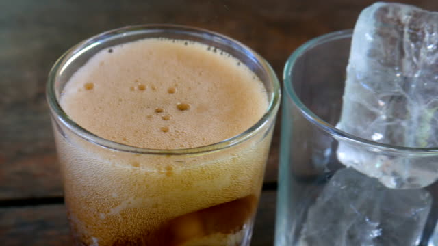Pouring Soft Drink to Three Glasses