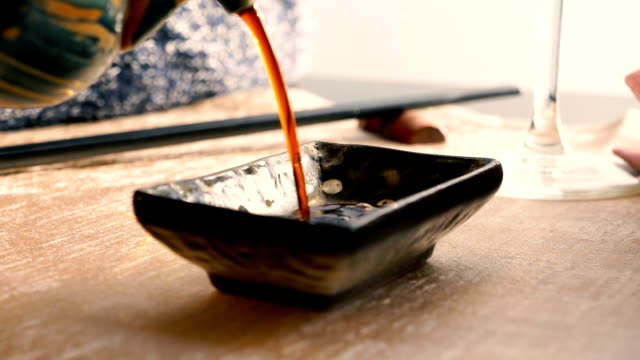 pouring soy sauce in a bowl - sauce stock videos & royalty-free footage