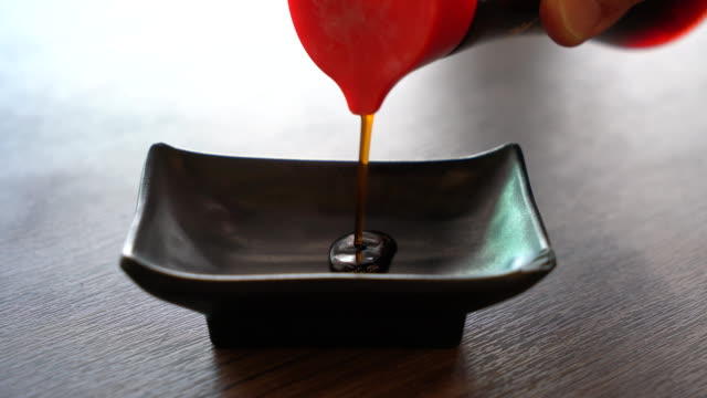 pouring soy sauce - sauce stock videos and b-roll footage