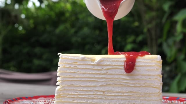 pouring strawberry jam on cake, slow motion - decoration stock videos & royalty-free footage