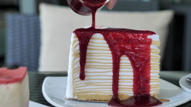 pouring strawberry jam on cheese cake - strawberry jam stock videos & royalty-free footage