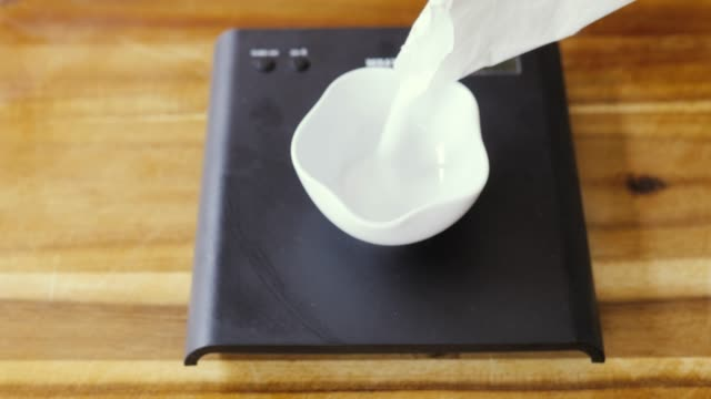 pouring sugar into bowl