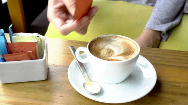 pouring sugar into cup of hot coffee, cappuccino. - sachet stock videos & royalty-free footage