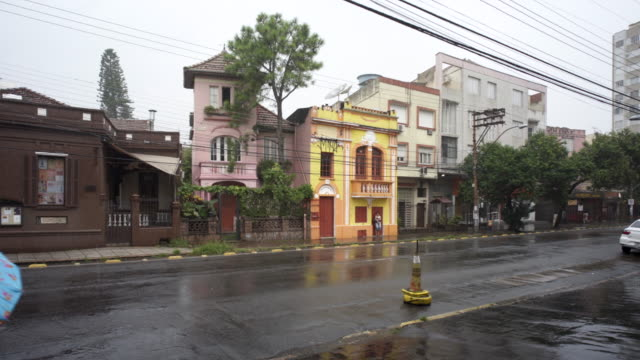 pouring summer rain in the city streets of porto alegre, southern brazil - alegre stock videos & royalty-free footage