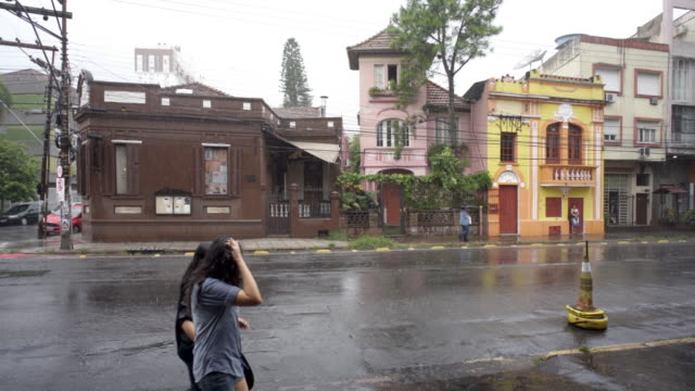 pouring summer rain in the city streets of porto alegre, southern brazil - porto alegre stock-videos und b-roll-filmmaterial