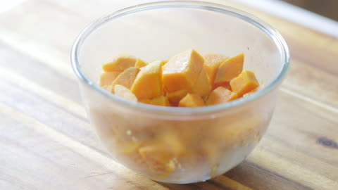 pouring sweet potato into a mixing bowl - sweet potato stock videos & royalty-free footage