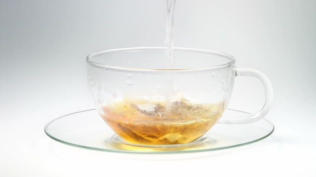 pouring tea - isolated - tea cup stock videos and b-roll footage