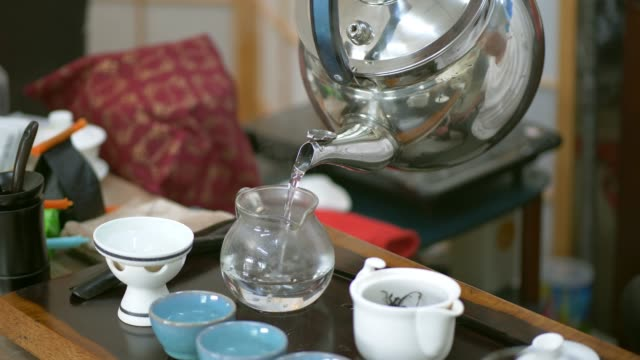 pouring tea process - chinese herbal medicine stock videos and b-roll footage
