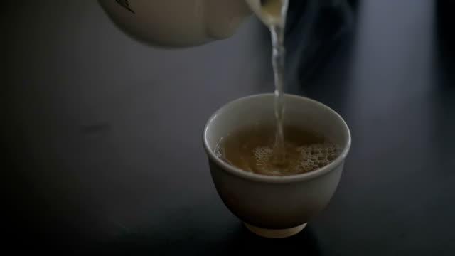 pouring tea, slow motion - teapot stock videos & royalty-free footage