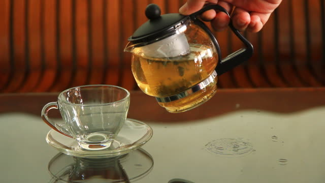 pouring tea - tea pot stock videos and b-roll footage
