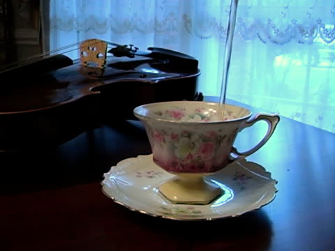 pouring tea - four objects stock videos & royalty-free footage