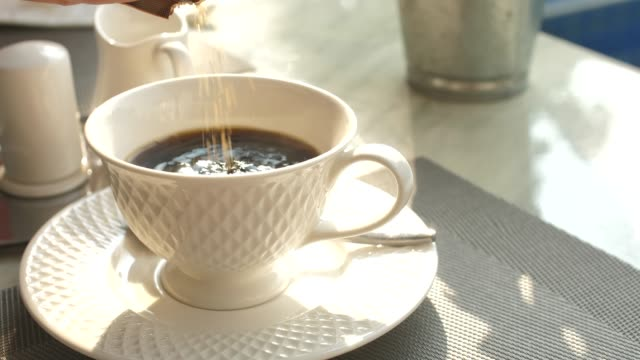 pouring the sugar into the coffee - stirring stock videos & royalty-free footage