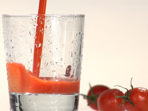 pouring tomato juice into a cold glass - tomato juice stock videos and b-roll footage