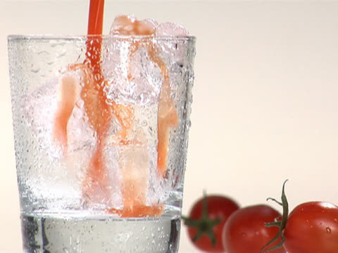 pouring tomato juice into a glass with ice cubes - tomato juice stock videos and b-roll footage