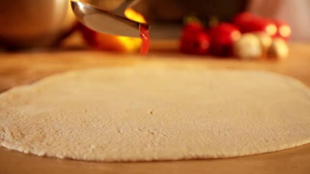 pouring tomato sauce