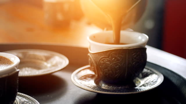 pouring turkish coffee at the cafe and shop - pouring stock videos & royalty-free footage