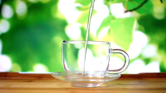 pouring water in glass tea cup - chinese tea cup stock videos and b-roll footage