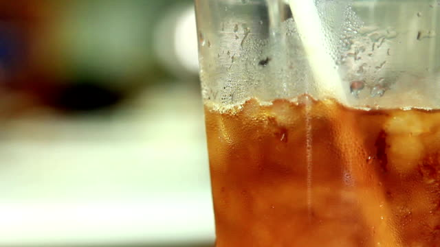 Pouring water in ice coffee