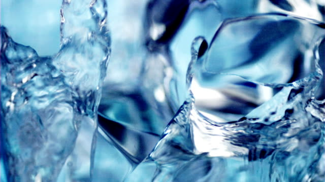 pouring water into a glass with cubes of ice. - drinking glass stock videos & royalty-free footage