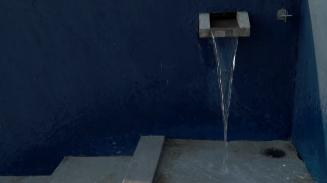 pouring water on floor - fermo video stock e b–roll