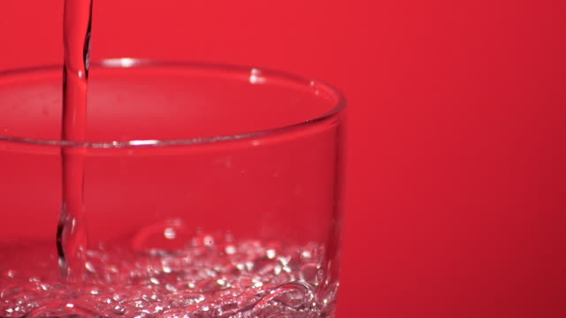 pouring water, soda in glass, slow motion - cachaça stock videos & royalty-free footage