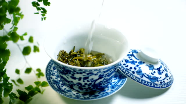 pouring water to tea cup - tea hot drink stock videos and b-roll footage