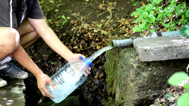 pouring water. - earth goddess stock videos & royalty-free footage
