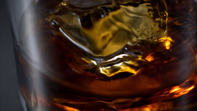 pouring whiskey on the rocks super slow motion - pouring stock videos & royalty-free footage