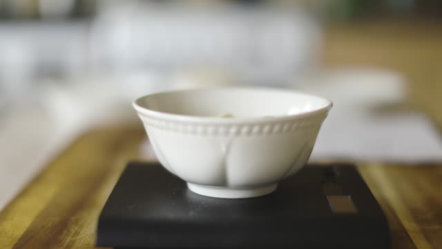 pouring white chocolate into small bowl for measuring - scales stock videos & royalty-free footage