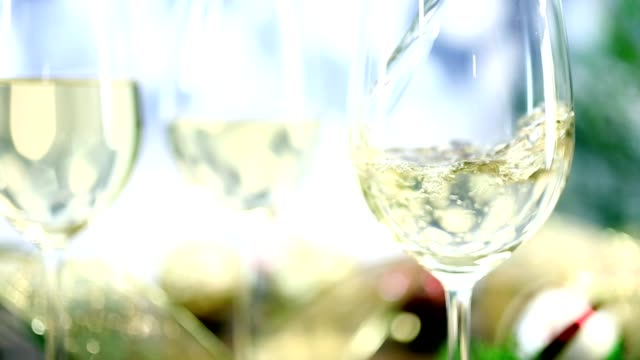 pouring white wine at christmas party. - white wine stock videos & royalty-free footage