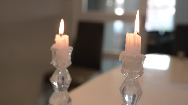 pouring wine and lighting candles for passover. the jewish communities throughout the world will celebrate the eight-day pesach holiday , which is to... - candle stock videos & royalty-free footage