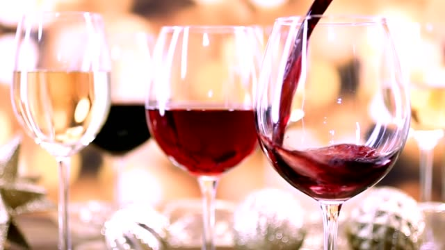 pouring wine at christmas party. - wine glass stock videos and b-roll footage