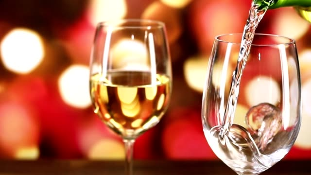 pouring wine at christmas party. - breakfast table stock videos and b-roll footage