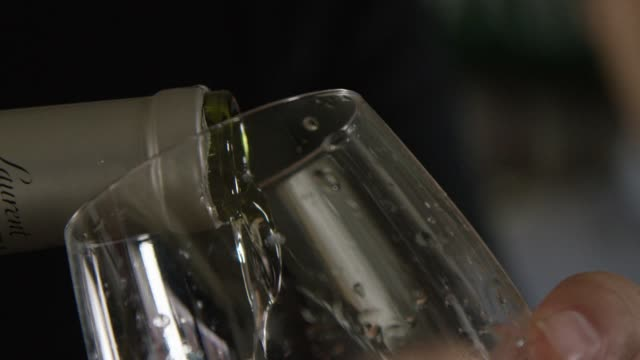 Pouring Wine into a glass - slow motion